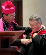 Archbishop Dennis Schnurr of Cincinnati gives the chain of office to the new Rector of Mount Saint Mary's Seminary of the West, Fr. Benedict O'Cinnsealaigh.